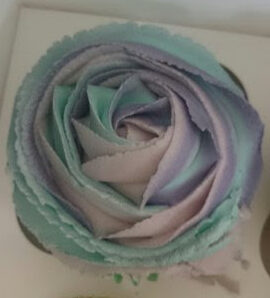 cupcake decorated in three colours swirled together