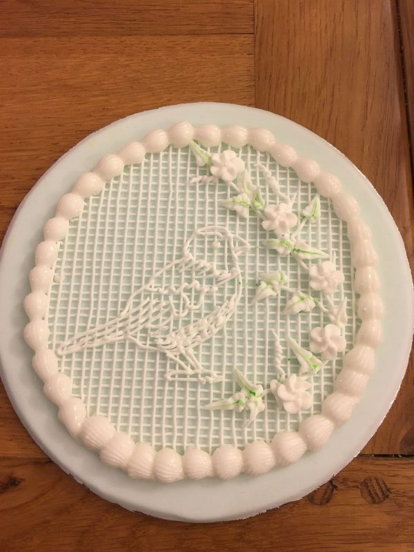 piped royal icing bird plaque