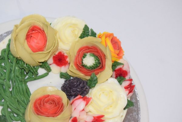 buttercream flowers on a cake