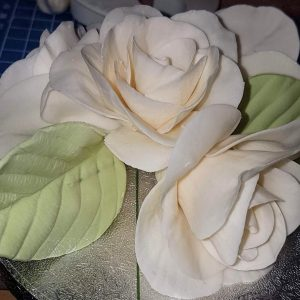 sugar roses with green leaves